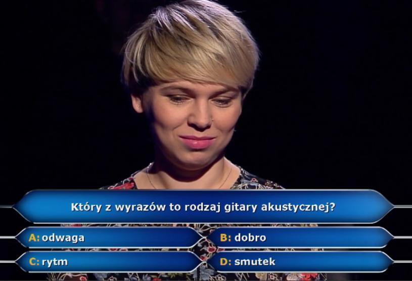"""250 tys. zł wygrała w """"Milionerach"""" Katarzyna Kołaczkowska. Choć gra na gitarze, nie zdecydowała się odpowiedzieć na pytanie za pół mln zł właśnie o ten instrument."""