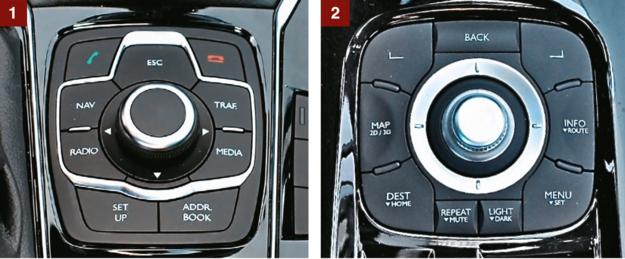 [1]  PEUGEOT Obsługa nawigacji wydaje się nieco zbyt skomplikowana – zwłaszcza na tle bardziej przemyślanego (choć też nie idealnego) odpowiednika produkcji Renault. [2] RENAULT Używanie nawigacji w Lagunie nie wymaga sięgania do deski rozdzielczej – odpowiedni panel, podobnie jak u rywala, zlokalizowano pod ręką, między fotelami. /Motor