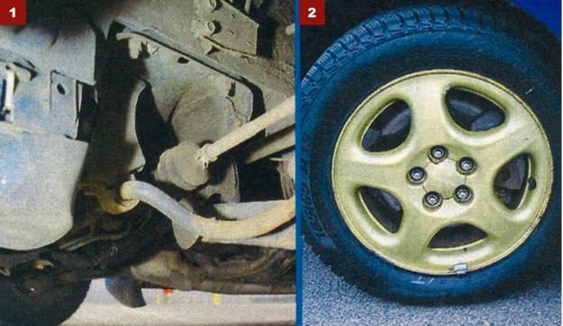 [1] Półosie napędowe wyglądają delikatnie, ale są wytrzymałe.[2] Obręcze kół w złotym kolorze element rozpoznawczy lmprezy. /Motor