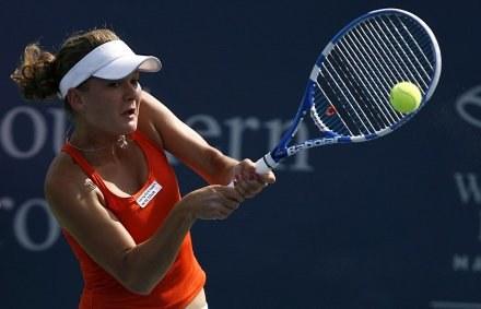 Agnieszka Radwańska i Caroline Wozniacki odpadły z turnieju w Toronto /AFP