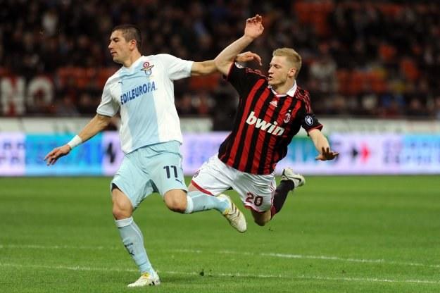 Aleksandar Kolarow (z lewej) w meczu z AC Milan /AFP