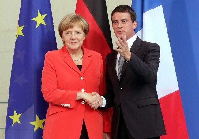Angela Merkel i Manuel Valls /PAP/EPA/WOLFGANG KUMM   /PAP/EPA