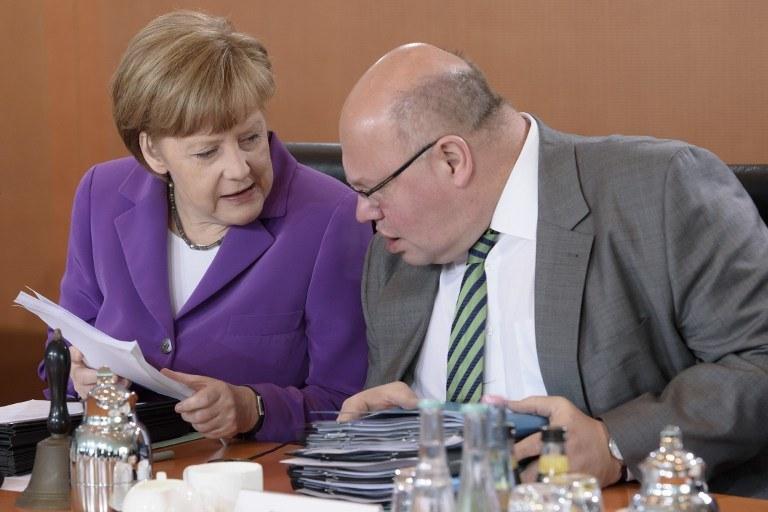 Angela Merkel i Peter Altmaier /CLEMENS BILAN / AFP /AFP