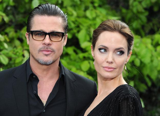 Angelina Jolie i Brad Pitt - obydwoje są miłośnikami tatuaży /Getty Images