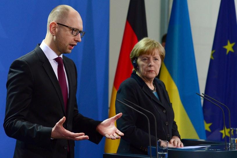 Arsenij Jaceniuk i Angela Merkel /AFP