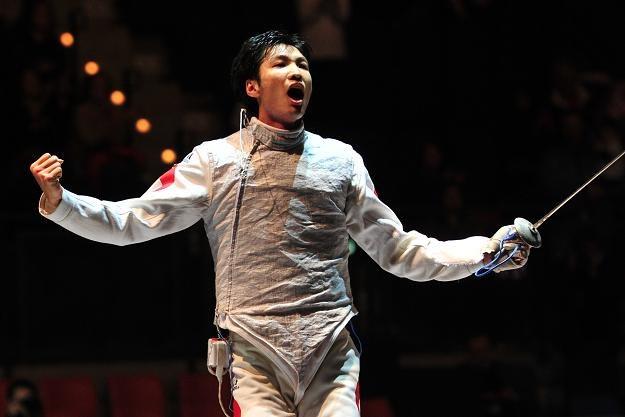 Chińczyk  Lei Sheng fetuje zwycięstwo z Francuzami. /AFP