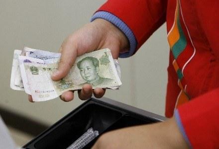 Chińskie władze chcą ukrócić proceder wymiany wirtualnych pieniędzy na realnym rynku /AFP