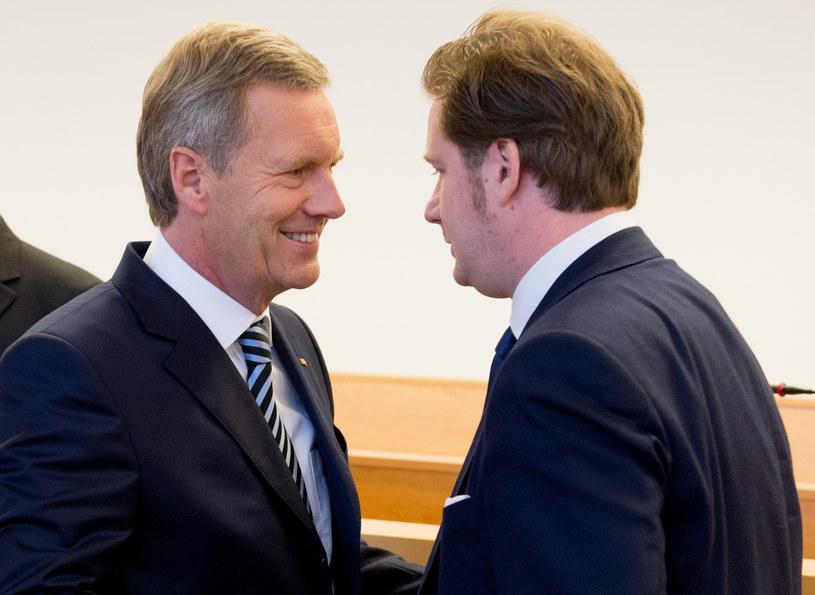 Christian Wulff (L) i David Groenewold /AFP