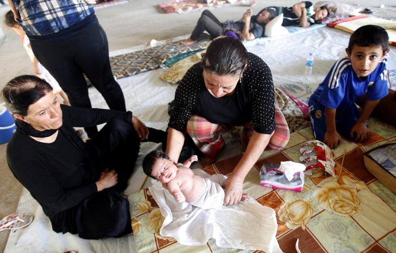 Chrześcijańska rodzina z Iraku, która musiała uciekać przed bojownikami Państwa Islamskiego /PAP/EPA