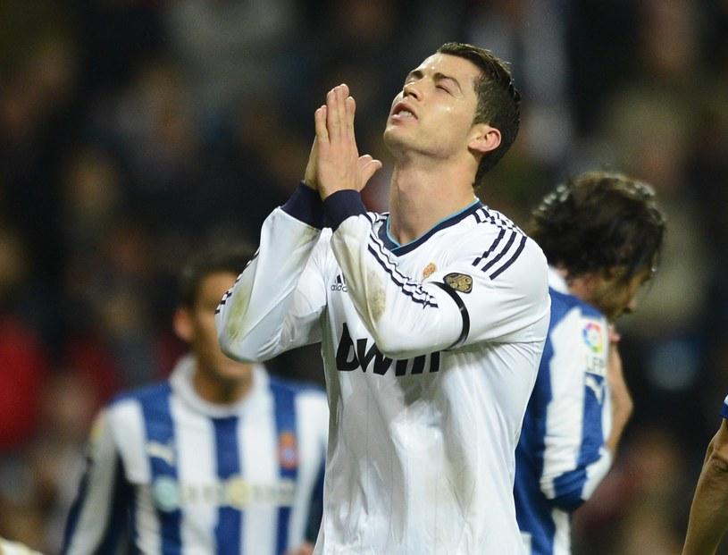 Cristiano Ronaldo modli się o cud /AFP