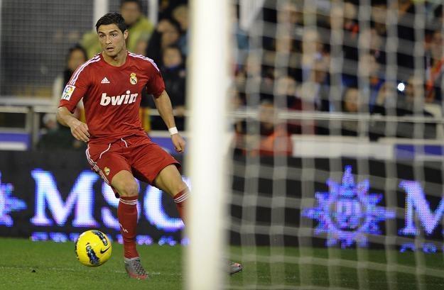 Cristiano Ronaldo strzela gola na 3-1 dla Realu Madryt. /AFP