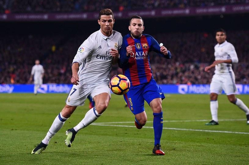 Cristiano Ronaldo (z lewej) z Realu i Jordi Alba z FC Barcelona /AFP