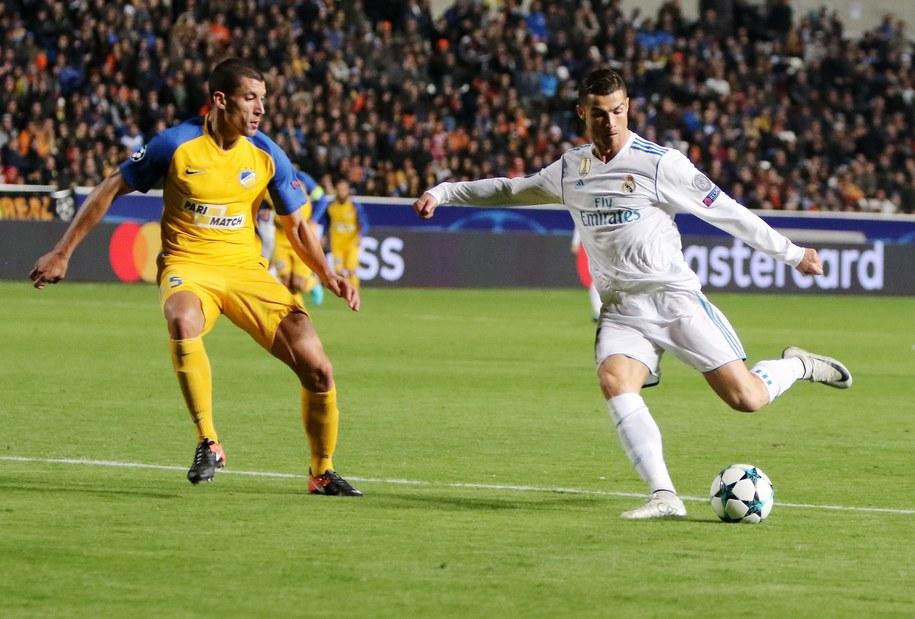 Cristiano Ronaldo z Realu Madryt i Jesus Rueda z APOEL-u Nikozja /KATIA CHRISTODOULOU  /PAP/EPA