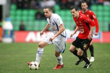 Dariusz Dudka (z lewej) grał do 73. minuty /AFP
