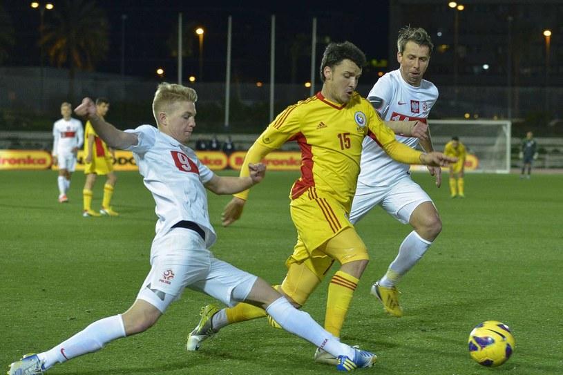 Dominik Furman (pierwszy z lewej) w meczu reprezentacji Polski /AFP