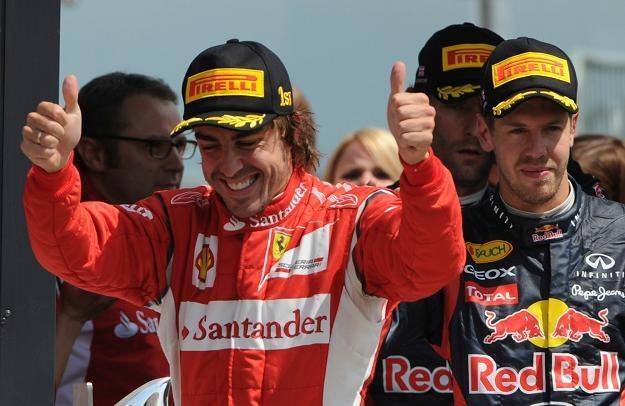 Fernando Alonso (z lewej)  i Sebastian Vettel /AFP
