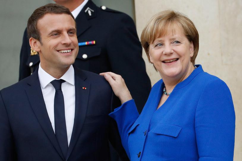 Francja i Niemcy znów zacieśniają stosunki. Na zdj. Emmanuel Macron i Angela Merkel /AFP
