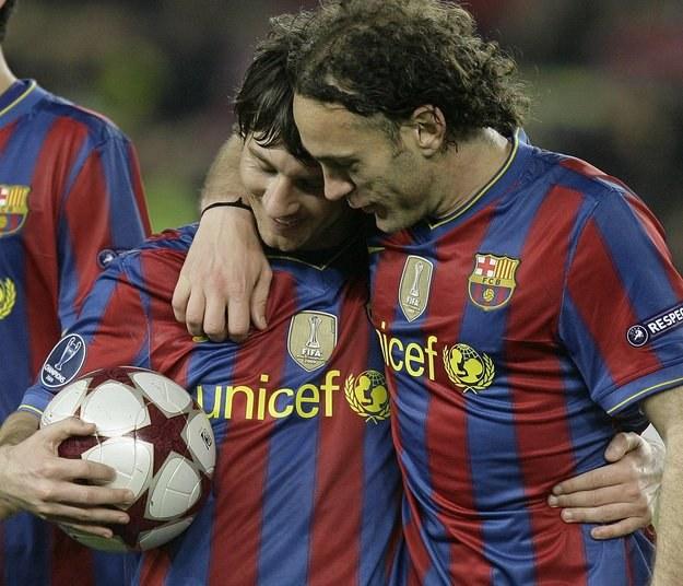 Gabriel Milito (z prawej), obok Leo Messi /AFP