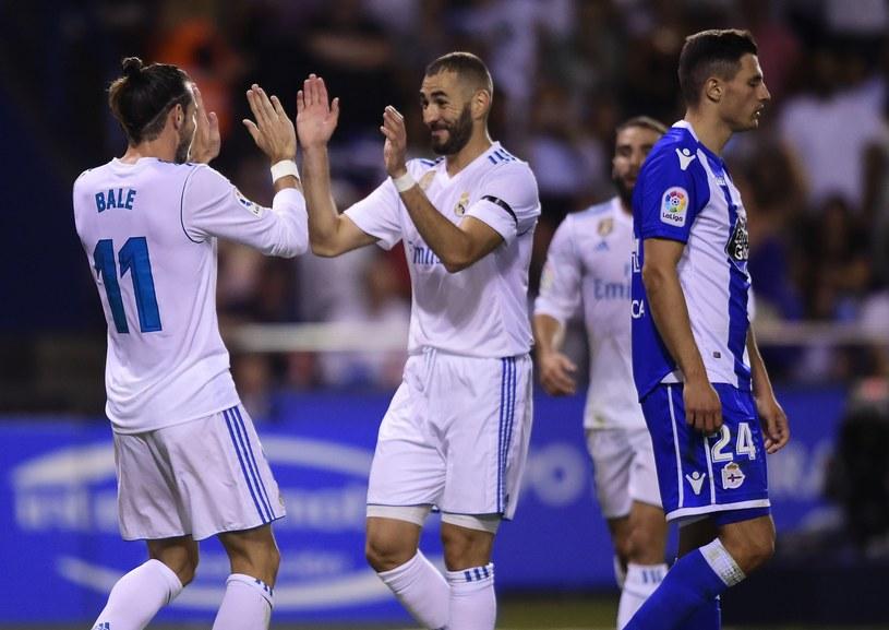 Gareth Bale i Karim Benzema cieszą się z gola, którego strzelił Walijczyk /AFP