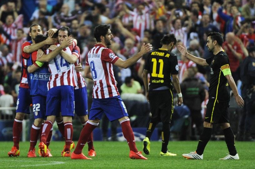 Gracze Atletico świętują, piłkarze Barcy we łzach /AFP