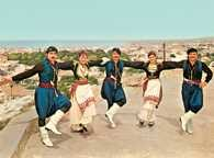 Grecja, Kreta, tancerze w strojach regionalnych /Encyklopedia Internautica
