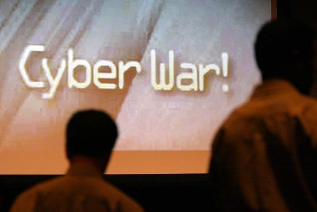 Hakerzy z Anonymous i LulzSec zapowiadają wspólną ofensywę w cyberprzestrzeni /AFP