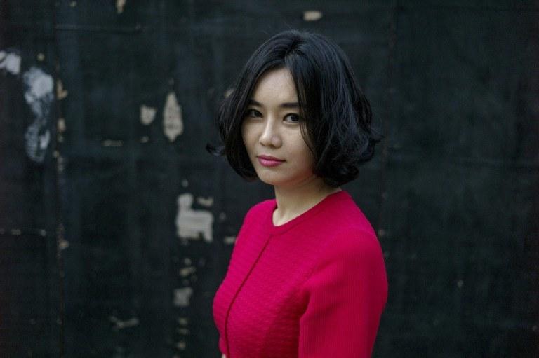 """Hyeonseo Lee jest autorką wspomnień """"Dziewczyna o siedmiu imionach"""". /FRED DUFOUR /AFP"""
