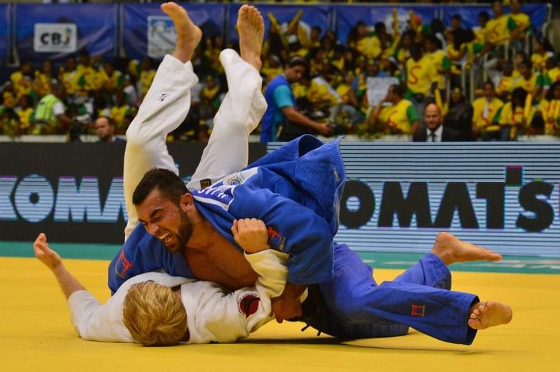 Ilias Iliadis (w niebieskim stroju) /AFP