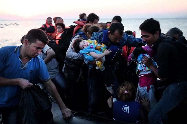 Imigranci na wyspie Kos /AFP