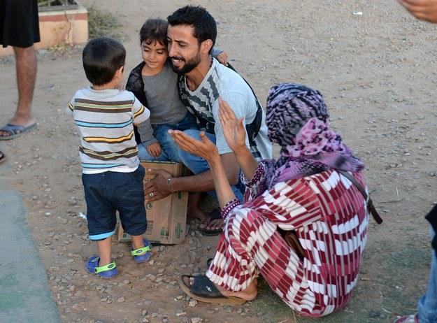Imigranci z Syrii (nz.) nie są ratunkiem dla polskiego rynku pracy /AFP