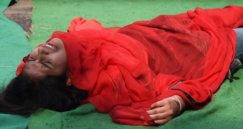 Indyjska aktywistka protestuje przeciwko przemocy seksualnej wobec kobiet w 2. rocznicę gwałtu na Jyoti Singh /AFP