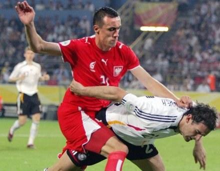 Ireneusz Jeleń (z lewej) nie rezygnuje z gry w kadrze /AFP