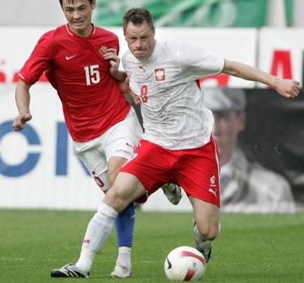 Jacek Krzynówek chce grać, a nie grzać ławę. /AFP
