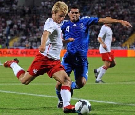 Jakub Błaszczykowski awansował z Polską na 36 miejsce rankingu FIFA /AFP