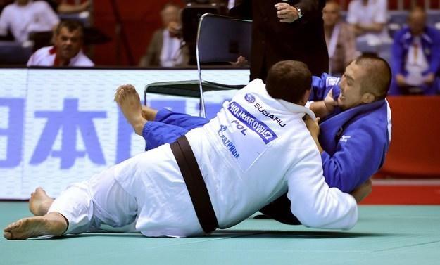 Janusz Wojnarowicz (w białym kimono) /AFP