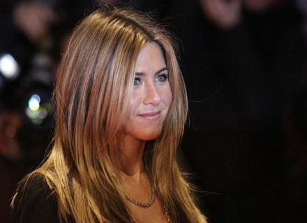 Jennifer Aniston chciałaby uciec z Hollywood /AFP