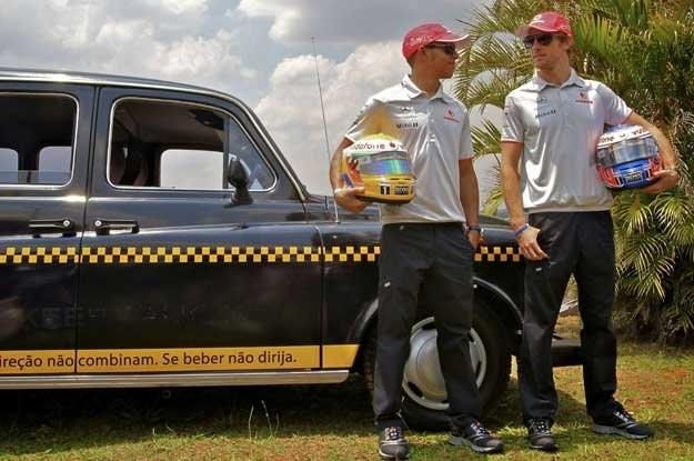 Jenson Button  (z prawej) i Lewis Hamilton /AFP