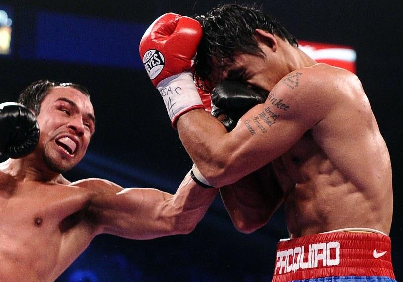 Juan Manuel Marquez (z lewej) i Manny Pacquiao /AFP