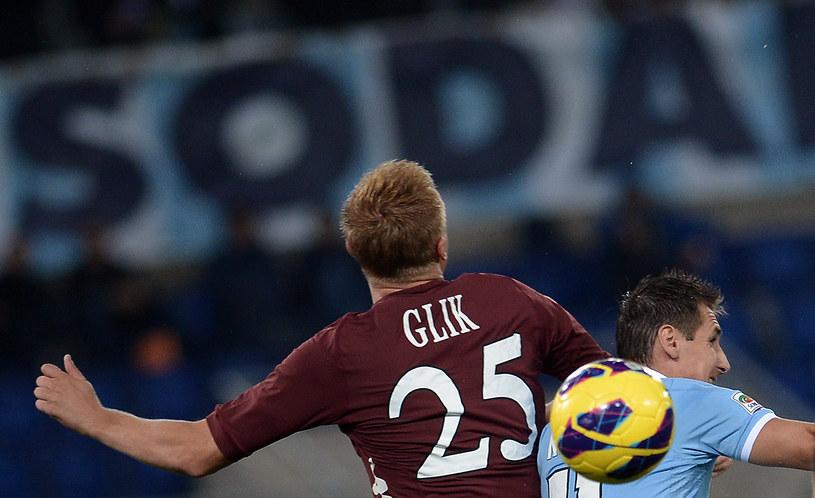 Kamil Glik kontra Miroslav Klose /AFP