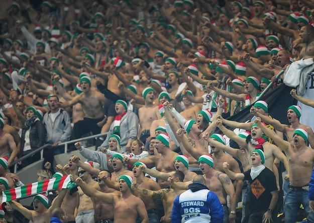 Kibice wspierali Legię na stadionie w Bukareszcie, a następnie powitali na warszawskim Okęciu /AFP