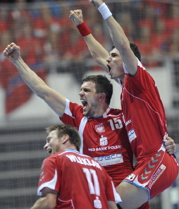 Krzysztof Lijewski (z prawej), z Michałem Jureckim i Damianem Wleklakiem. /AFP