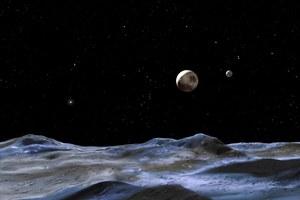 Księżyc Plutona z oceanem ciekłej wody?