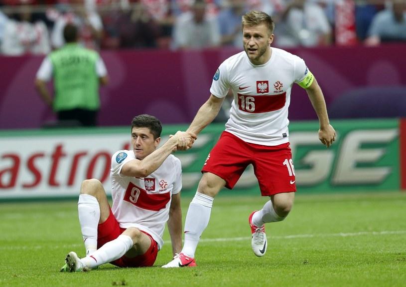 Kucharski: Gdybyśmy mieli cały zespół taki jak Kuba Błaszczykowski (z prawej), Robert Lewandowski (z lewej) i Łukasz Piszczek, to na Euro 2012 zdobylibyśmy medal. /AFP
