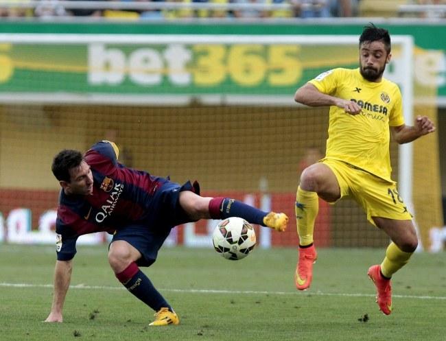 Lionel Messi został kontuzjowany podczas meczu z Villarreal /DOMENECH CASTELLO /PAP/EPA
