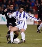 Luis Figo (z lewej) nie pomógł Realowi