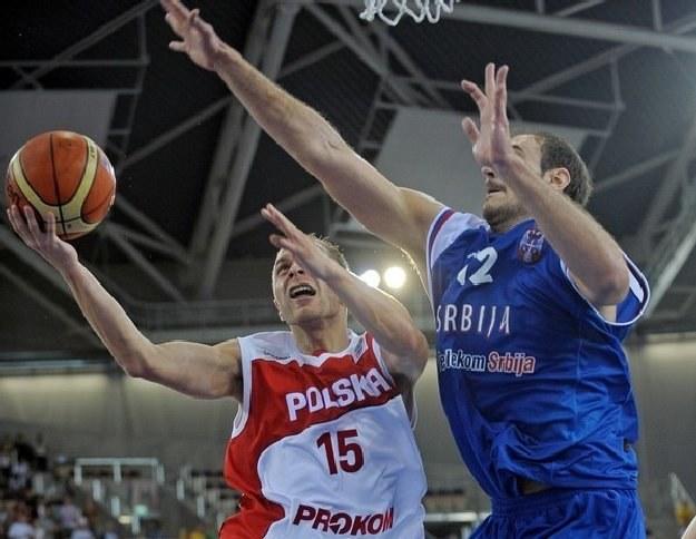 Łukasz Koszarek (z piłką) /AFP