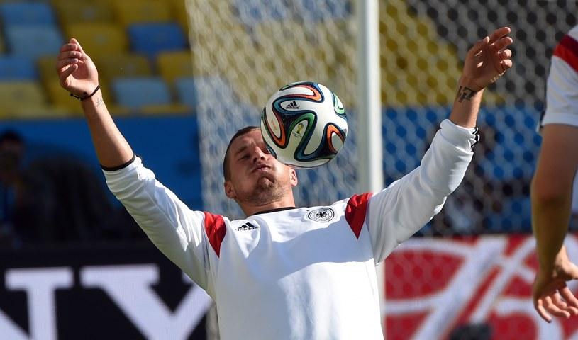 Łukasz Podolski czeka na swą kolejną szanse na mundialu. /AFP