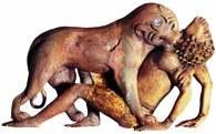 Lwica rozszarpująca młodzieńca, fenicka rzeźba z kości słoniowej, VIII w. p.n.e. /Encyklopedia Internautica