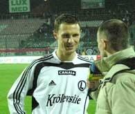Marcin Rosłoń był po meczu obiektem zainteresowania swoich kolegów po fachu /legia.net
