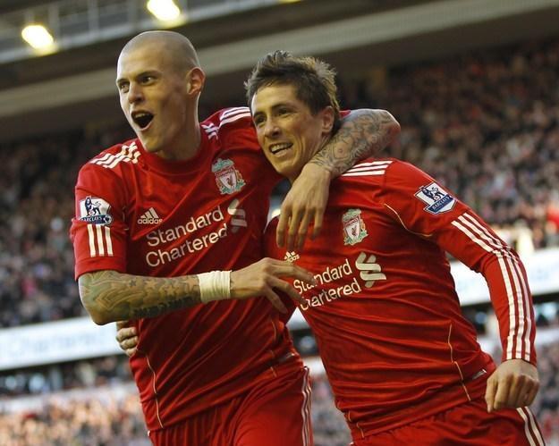 Martin Skrtel i Fernando Torres - piłkarze Liverpoolu, z którym chętnie zmierzyłby się Lech /AFP